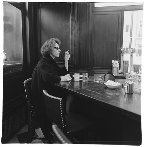 Woman at a counter smoking, N.Y.C., 1962 (Diane Arbus)